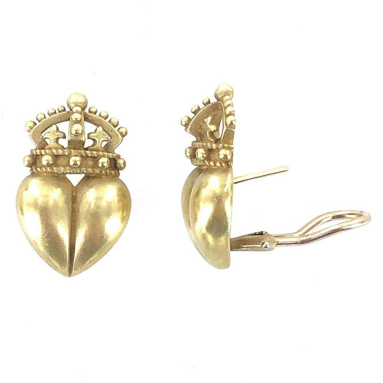 Kieselstein-Cord Heart and Crown Earrings are crafted in 18 karat yellow gold. The satin finished gold is Kieselstein's hallmark. The earrings measure 15 x 25mm, and feature lever backs. Signed Kieselstein Cord 18k c 1987.