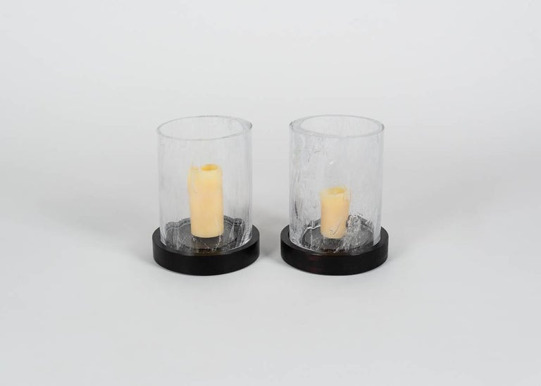 The cylindrical shape and clouded obscurity of this wrought crystal piece summons the image of a hurricane surrounding the candle, filtering the light as storm clouds do the sun.