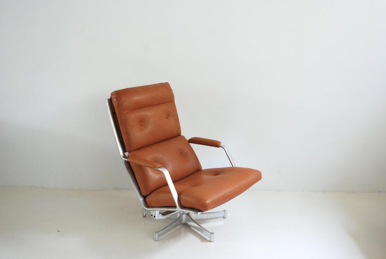 This lounge chair FK 85 was made by Jorgen Kastholm & Preben Fabricius for Kill international. The lounge chair has a swivel aluminium frame and soft cognac natural leather. It was new upholstered with soft premium aniline leather. The touch of