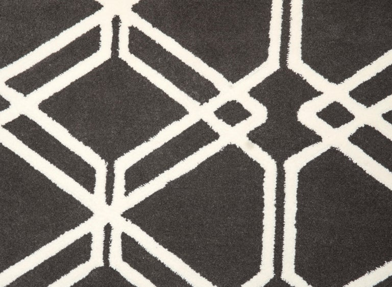 This rug is handmade in Spain using the hand tufted technique. We use only the finest natural yarns, 100% pure virgin wool with a thickness of 15mm.   - Customize in any size and in any color upon request. - Care: Vacuum clean when required. -