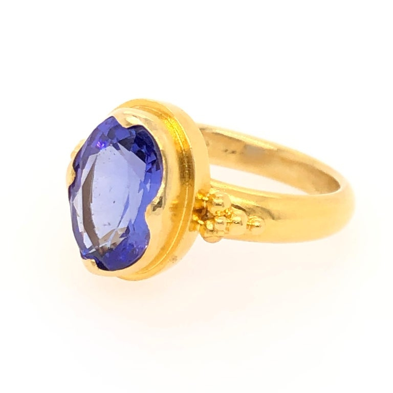 Tanzanite, named after the country Tanzania, is a relatively newly discovered semiprecious stone. Tiffany's is credited with introducing it to the market in 1968, and since then designers have turned to tanzanite for its beautiful colors (most