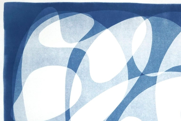 This is an exclusive handprinted unique cyanotype that takes its inspiration from the mid-century modern shapes. It's made by layering paper cutouts and different exposures using uv-light.   Details: + Title: Urban Curves and Forms I + Year: 2021 +
