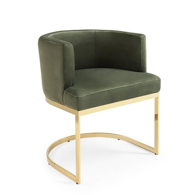 Armchair Kindly with structure in solid wood and upholstered with olive green vellvet fabric. With gold metal base. Also available upholstered with turquoise velvet fabric and with chrome metal base.