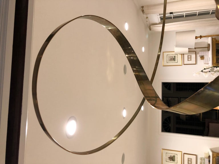American Kinetic Brass Ribbon Sculpture Set on a Tall Metal Stand in the style of Jere. For Sale