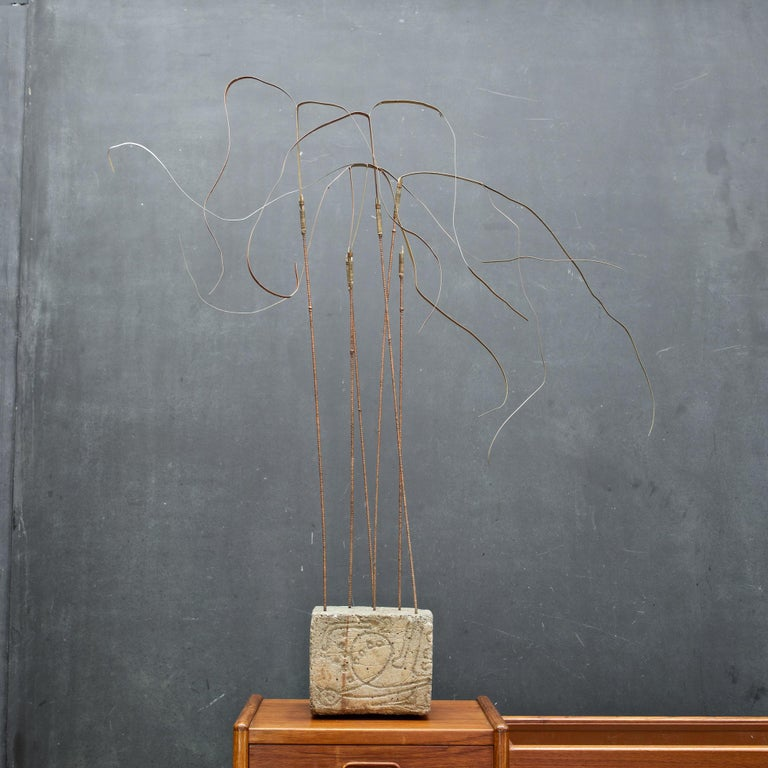 Interesting kinetic tall grass / reeds sculpture on impressed or molded base. Fair vintage condition, showing wear to base. Measures: Base is W 6½ x D 6 in. Total height is 34 in.