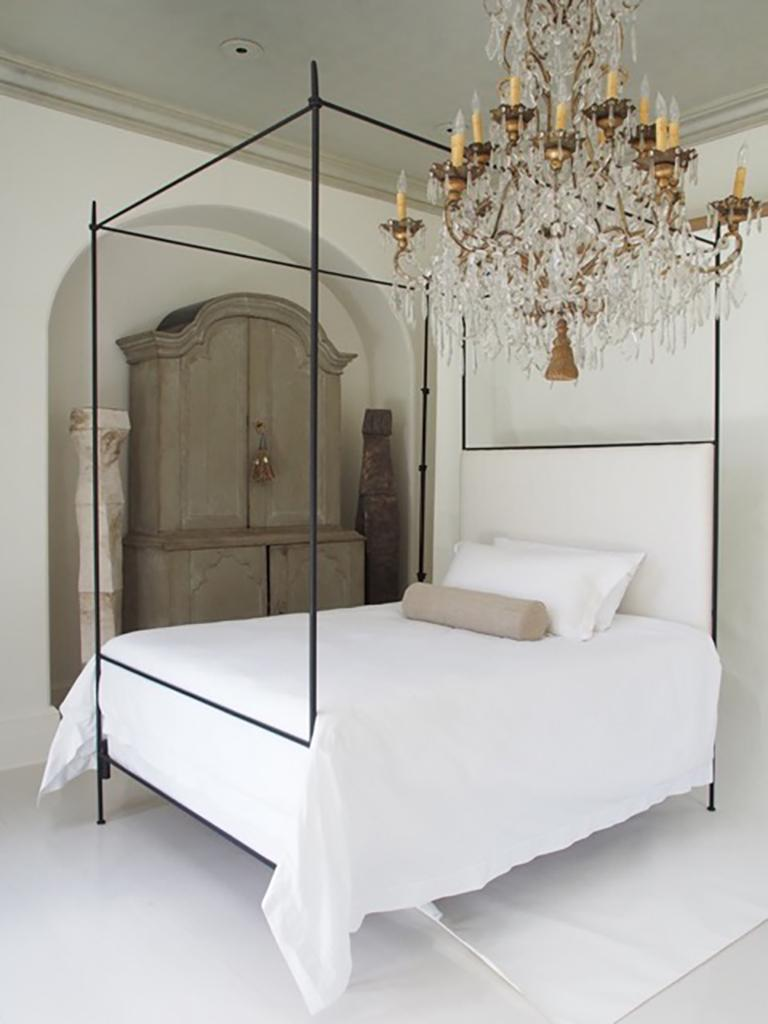 King, this iron Louis XVI style canopy bed with upholstered headboard from the custom Tara Shaw Maison collection. Handcrafted in New Orleans. Standard headboard upholstered in a white heavyweight Belgian linen. Available in king, queen and twin