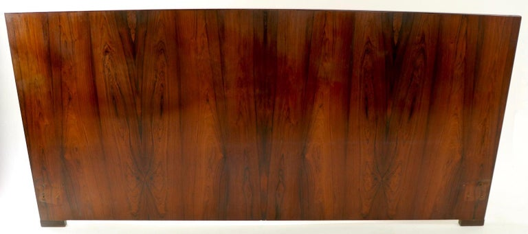 Stunning king size rosewood headboard by Dyrlund. Hard to find the large size headboards, especially in rosewood. This example has a slight warp to the board, however once attached ton you bed frame it is inconsequential - please see images.