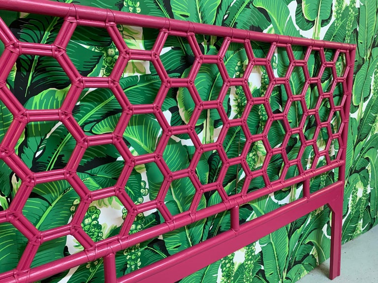 King headboard constructed of rattan in a honeycomb design features a rich, dark pink glossy finish. Very good condition with only very minor imperfections consistent with age.