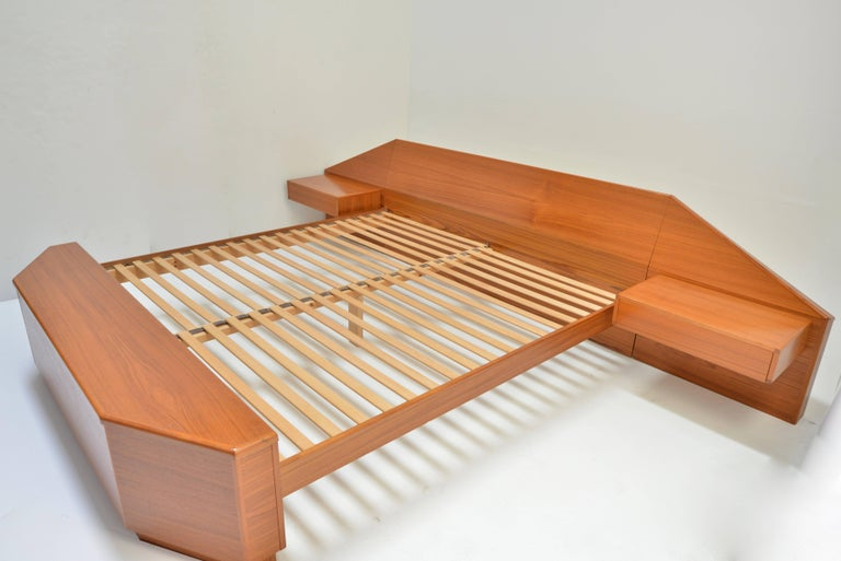 King size teak platform bead with floating nightstands and footboard chest by Danish modernist Laurits M Larsen. In excellent condition. Fits standard king mattress.