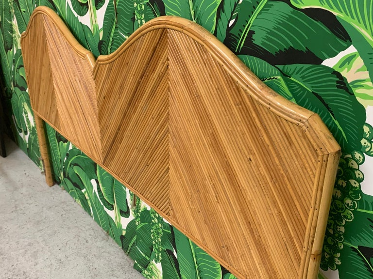 King size bed headboard features a full veneer of pencil reed rattan in a geometric pattern in the manner of Gabriella Crespi. Very good vintage condition with only very minor imperfections consistent with age.  B4123
