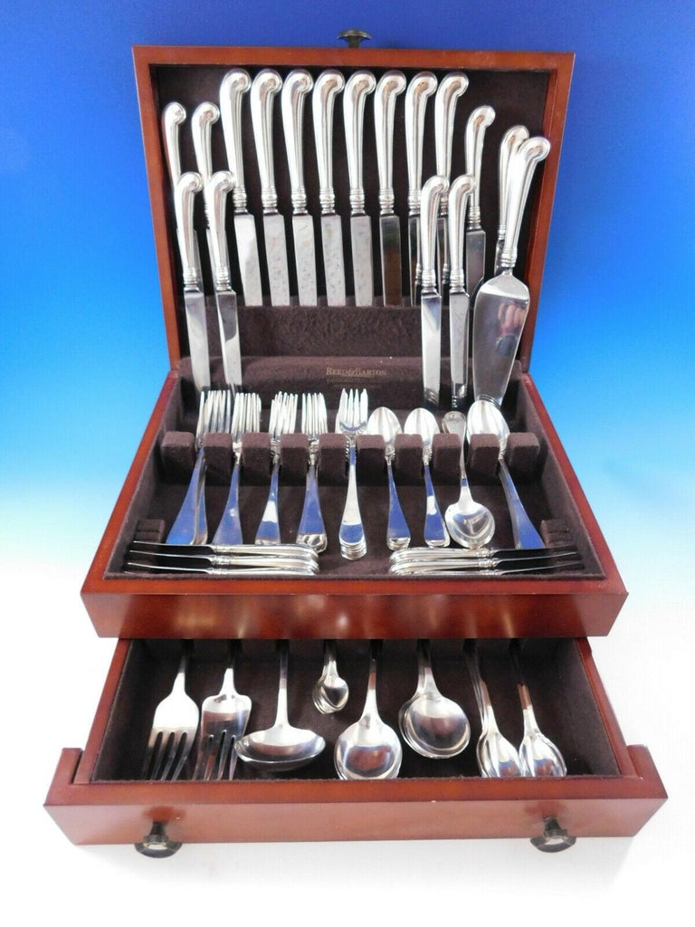 Superb King William by Tiffany and Co. sterling silver flatware set, 92 pieces. This old English style pattern was introduced in the year 1870. The pieces are large and heavy, with wonderful pistol grip handle knives. This set includes: