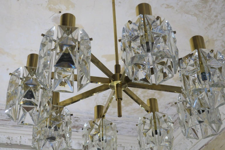 Kinkeldey midcentury crystal glass and brass chandelier, 1960s with faceted glass hanging from a brass frame. Fine and elegant piece.