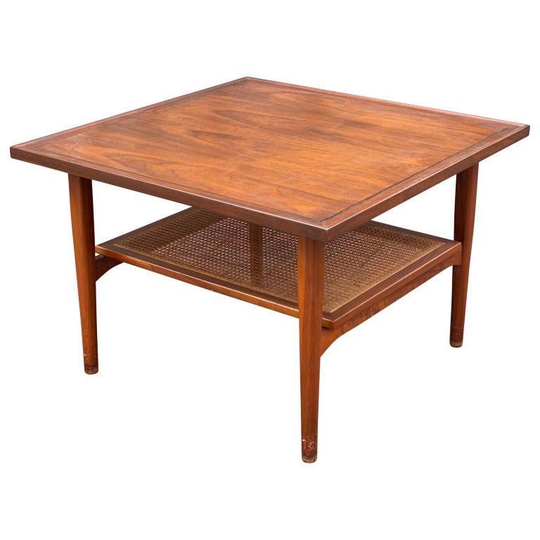 Vintage, Mid-Century Modern walnut and cane two tier coffee table or side table by Kipp Steward for Drexel Declaration. Not easily found, this beautiful square table has been expertly refinished to restore it's original glow. The caned lower shelf