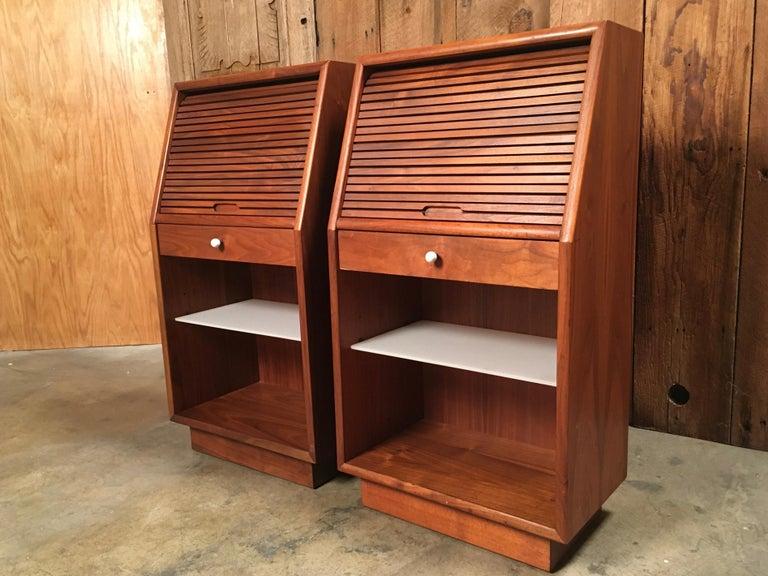 A pair of Kipp Stewart for Drexel declaration tambour door nightstands with original milk glass shelf.