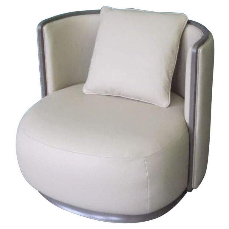Kir Royal/A Upholstered Curved Armchair with Wooden Frame For Sale