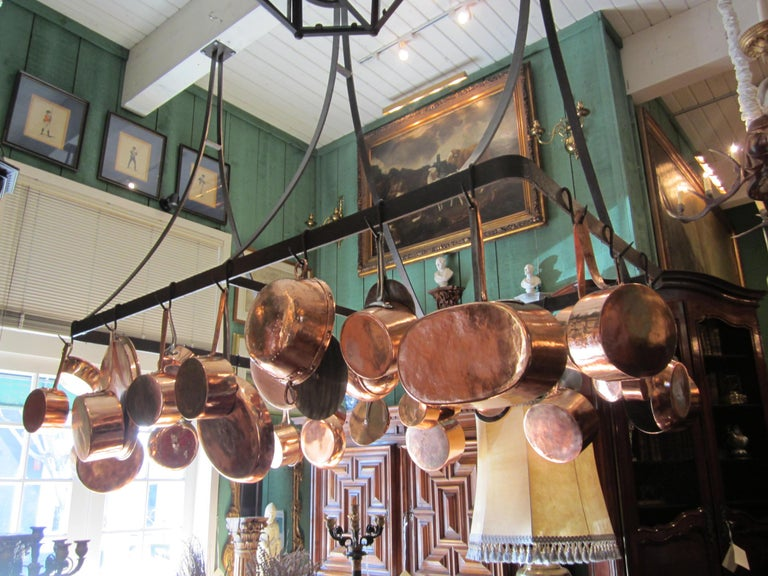 Kitchen Ceiling Mounted Pot Rack With Antique Copper Pots