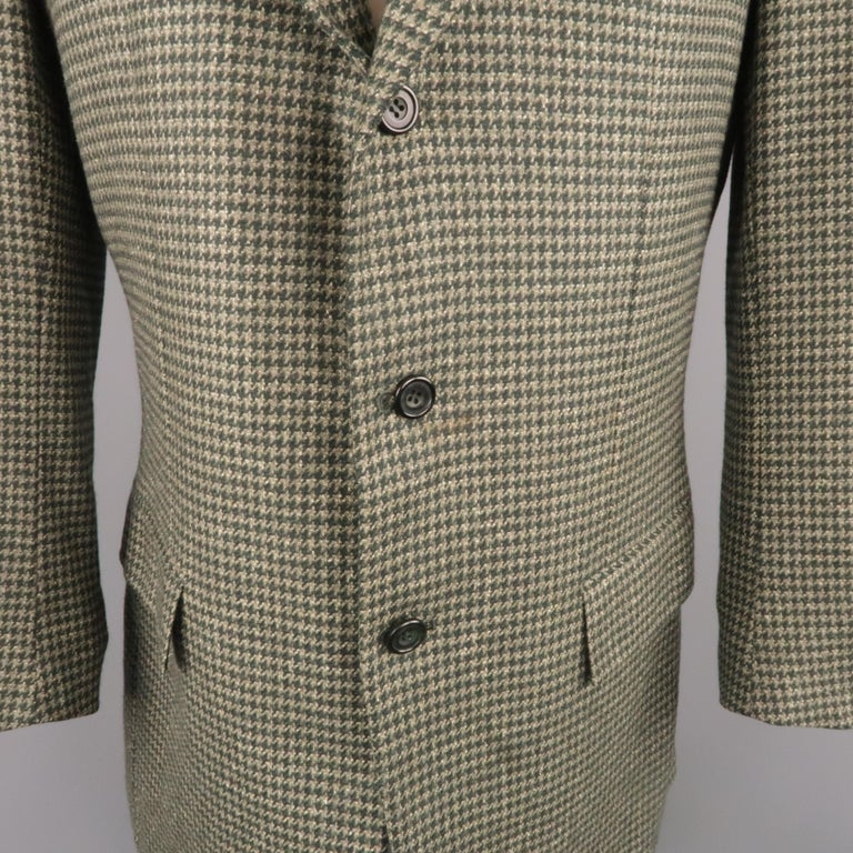 Vintage KITON sport coat comes in green houndstooth cashmere with a notch lapel, single breasted,  three button front, silk lining, and functional button cuffs. Spot on front. As-is. Made in Italy.   Good Pre-Owned Condition. Marked: IT 50