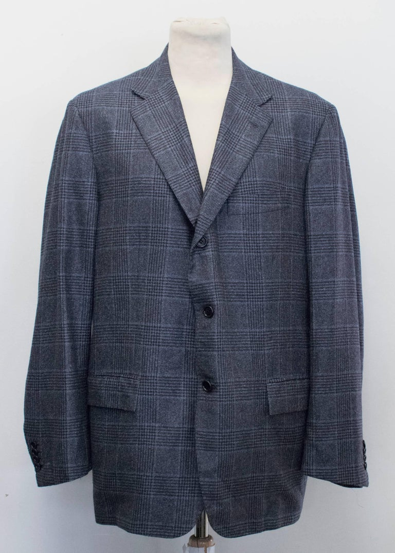 Kiton for Jean Jacques blue and black checked jacket. Shoulder pads. Notch lapels. Two functional flap pockets on the front. Two interior pockets with button enclosure. Three buttons down the centre. Medium weight.   Condition: 10/10  Measurements: