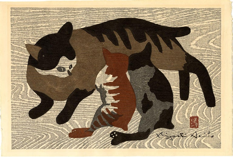 A striped mother cat feeds her two kittens. The background is a grey woodgrain, which gives the work a delightful feeling of floating. There is a layer of woodgrain-patterned mica that has been layered atop the design. Saito designed a similar work