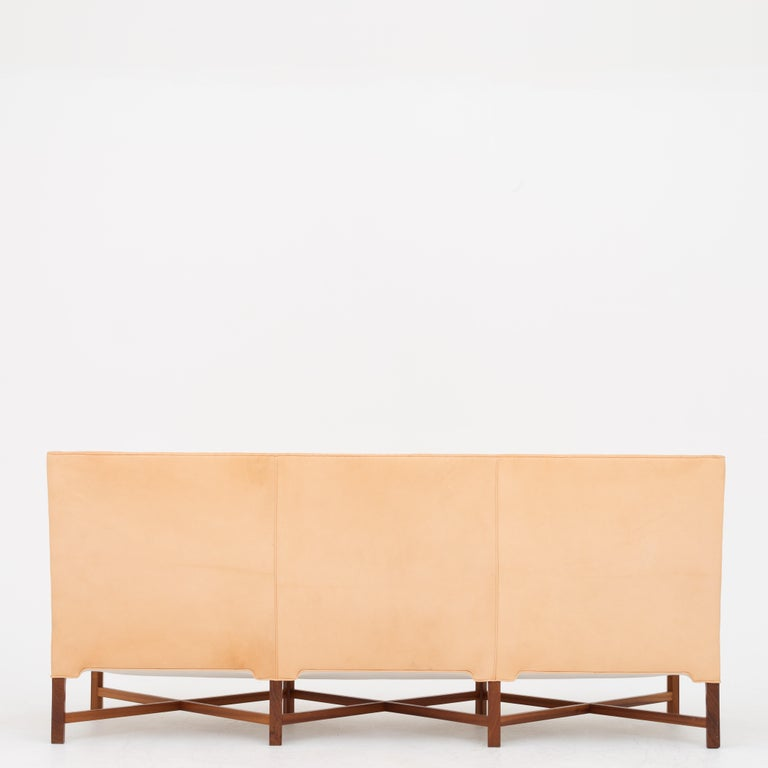 KK 4118, 3-seat sofa with solid mahogany crossed legs and new niger leather. Designed in 1929. Maker Rud. Rasmussen.