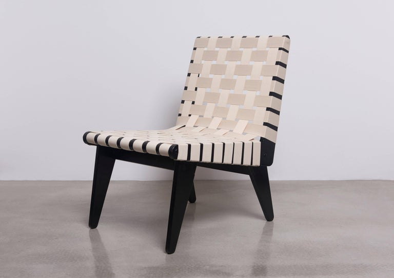 Restored black and off-white strapped lounge chair by Klaus Grabe in mint condition.