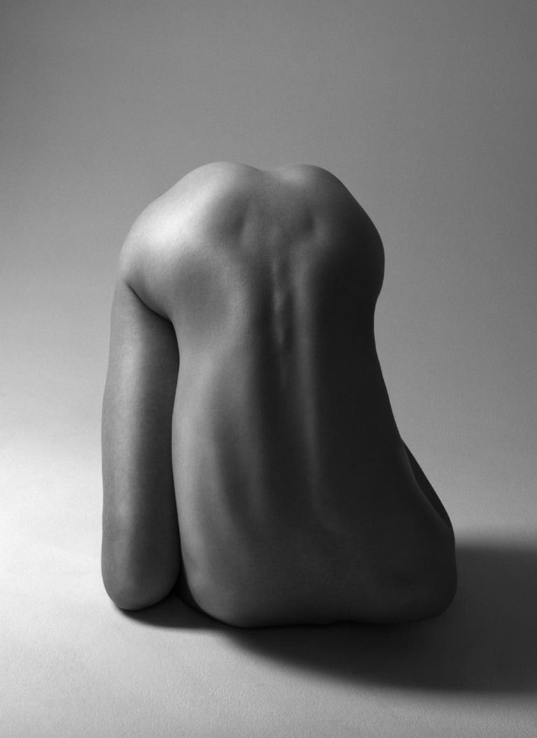 156.03.11 is a limited-edition black & white photograph by contemporary artist Klaus Kampert from the series entitled Torsi. In this series the model is stripped of identity. The poses adopted and the absence of heads produce enigmatic and