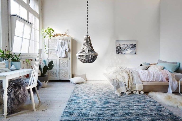 The klaylife Sash is a handmade, modern chandelier with a Classic style. An extension to the L.I.M klaylife chandelier, but with the added detail of a top band and belly band that accentuates the line and length of the clay beaded chandelier. The