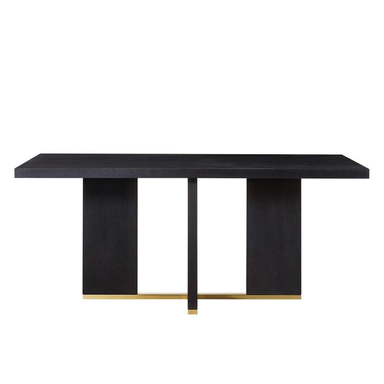 Dining table Klein with all structure in solid poplar wood in black tinted finish and in solid beech wood. With base in polished stainless steel in gold finish.