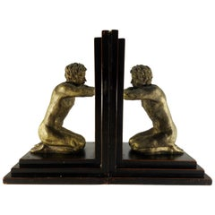Kneeling Men's on Wood Bookends with Mirrors