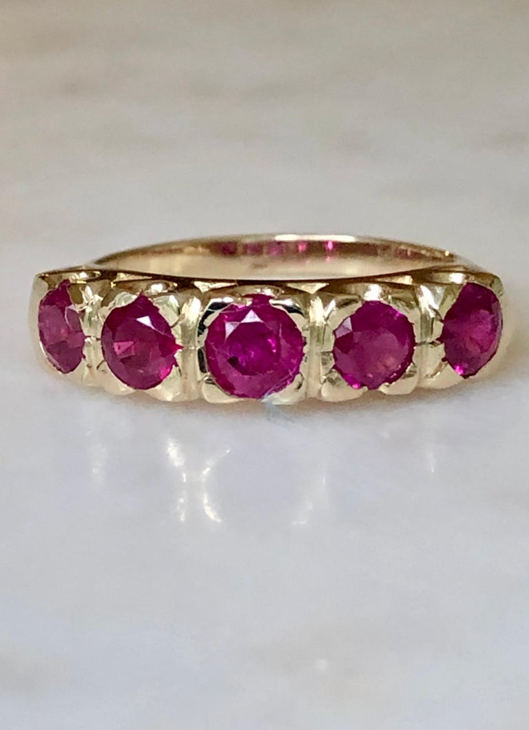 Beautiful yellow gold 1.90 Carats Natural Burmese Ruby Fishtail Mounting Anniversary Antique Style Ring - Size 6 3/4.  This yellow gold 14K  anniversary band is stunning!   The ring has a fishtail style mounting that holds (5) round cut Burma rubies