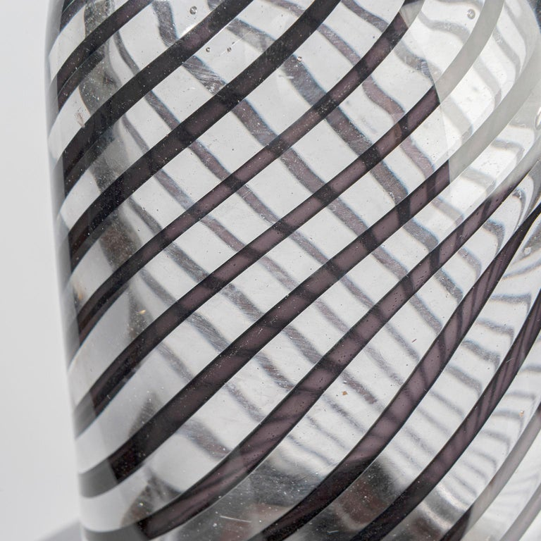 Copper glass: polished and sandblasted. Transparent and black stripes attached. Hand blown in Leerdam, the Netherlands.