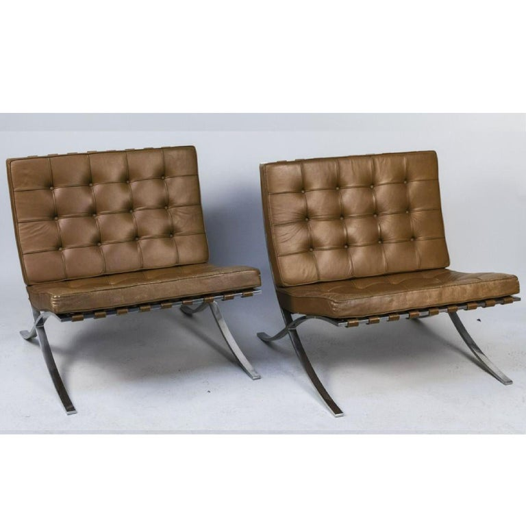 Knoll Barcelona lounge chair, stainless steel, Mies van der Rohe, circa 1961. Deep chestnut brown original leather, straps in-tact, highly sought after original stainless steel frame. Label intact on one chair - see photos. Knoll Park Ave address on