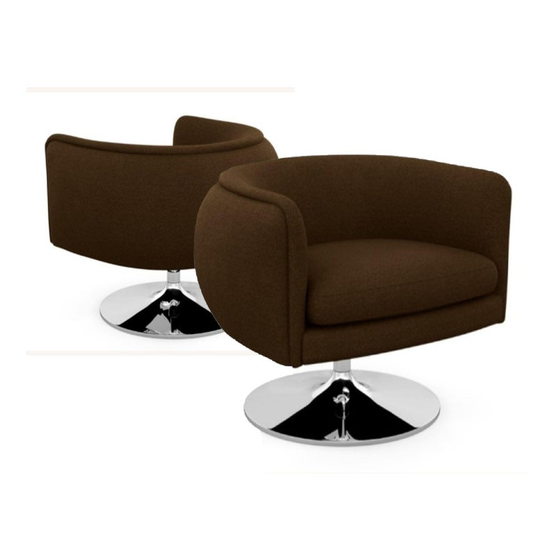 Knoll D'Urso modern swivel club lounge chair in Pumpernickel wool Bouclé, stainless steel base. The D'Urso swivel chair strikes a playful balance between formality and whimsy, offering a modern twist on the classic cocktail lounge chair. Designed by