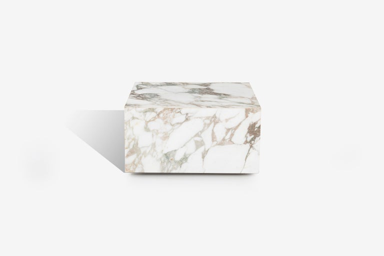 Knoll Gae Aulenti style Calacatta cube coffee table, solid marble cube appearance, constructed with marble supports on underside with hidden wheels for easy placement and clean reveal appliance.