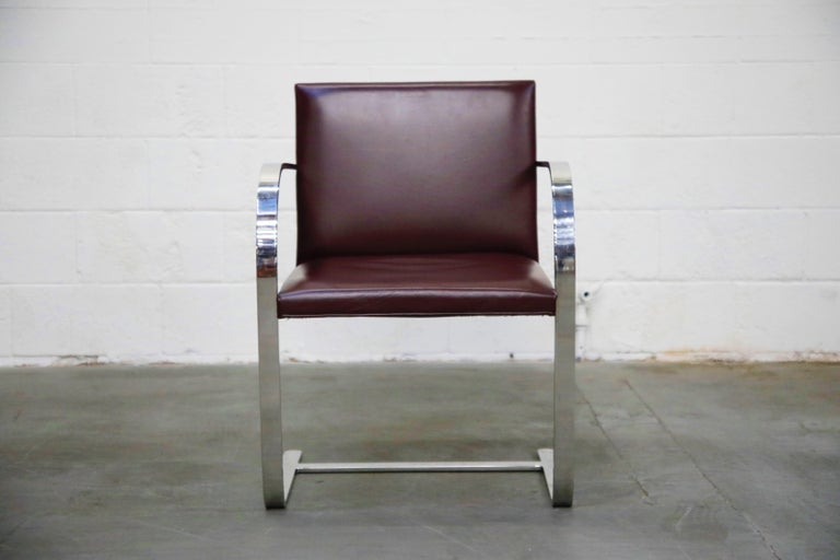 This set of six (6) signed (authentic) Knoll International 'Brno' Chairs are in an incredible deep burgundy leather. These collectible 2nd generation productions by Knoll International have an attractive and lovely patina to the leather and is