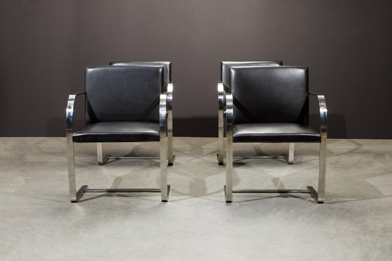 This set of four (4) signed (authentic) Knoll International 'Brno' Chairs are in an incredible black leather. These collectible 2nd generation productions by Knoll International have an attractive and lovely patina to the leather and is signed and