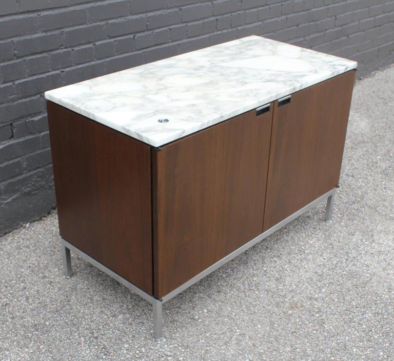 Authentic Florence knoll credenza with marble top. Includes original Knoll branded key to lock the doors. All 4 adjustable levelers are intact. Very good original condition.