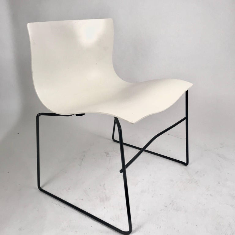 45 available stacking indoors /outdoors Knoll Vignelli handkerchief chairs in white with black wrought iron frame. Intended to evoke the windblown contours of a handkerchief blowing through the air, the generously scaled chair is practical and