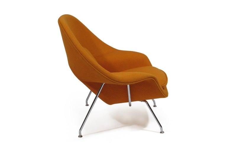 Eero Saarinen for Knoll Medium Womb chair foam covered molded fiberglass upholstered in Knoll CATO orange wool on polished chrome legs.