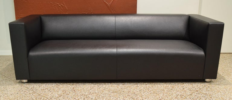Stylish and streamlined sofa by Peter Shelton and Lee Mindel for Knoll. Upholstered in a black Knoll Textile (Prairie Bison) paired with polished stainless steel legs. Signed with manufacturer's tag and KnollStudio metal plate underneath. Made in