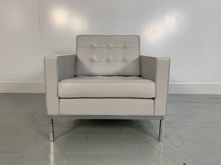 "On offer on this occasion is a rare, original ""Florence Knoll"" lounge chair from the world renown furniture house of Knoll Studio, dressed in their sublime Knoll ""Volo"" leather in pale-grey, and with polished chrome framework.