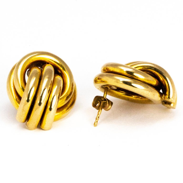 These classic knot style stud earrings are modelled out of 9ct gold. This pair of earrings are on the large side and and are fantastic statement jewellery.   Earring Dimensions: 22mm x 19mm