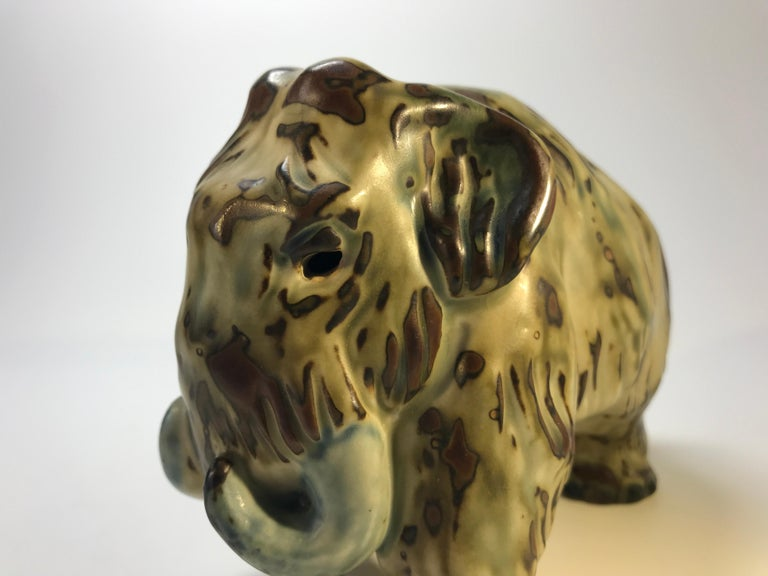 Knud Kyhn designed this sung glazed stoneware Mammoth in the 1920's for Royal Copenhagen, Denmark.  This item was purchased 45 years ago at Georg Jensen in New York and is in 'as new' condition Signed and numbered 20207, Measures: height 4 inch,