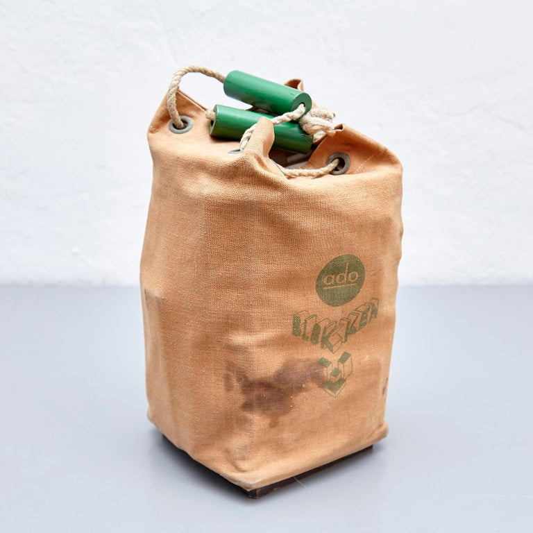 Toy designed by Ko Verzuu, circa 1930. Manufactured by ADO in Netherlands.  ADO Blokken, canvas bag with a set of wooden blocks / cubes to play.  In good original condition, with minor wear consistent with age and use, preserving a beautiful