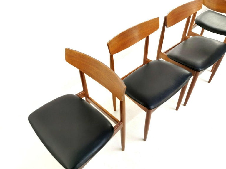 Set of 4 G Plan dining chairs  Kofod Larsen dining chairs from the G Plan Danish Range.   Made from teak and vinyl upholstery.   G Plan's Danish Range was aimed at the top end of the market.   1960s. Made in the UK.  Dimensions (cm): W 50
