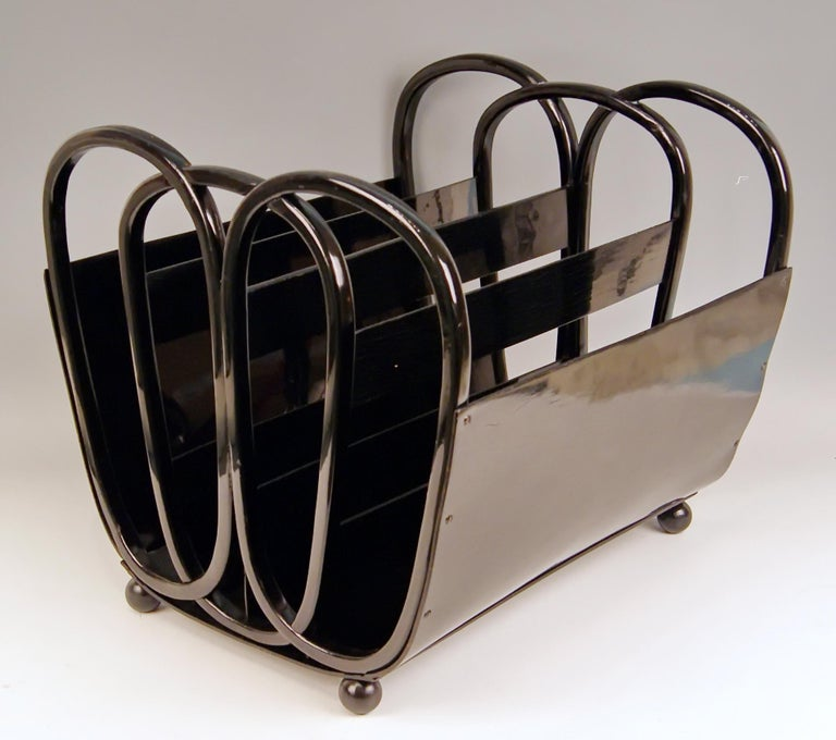 Kohn Vienna newspapers or magazine rack, model number 1070  beech wood (bentwood) and plywood, black stained or highest quality handwork or of most elegant form type:  Please note the elegant lateral struttings causing a certain impression of