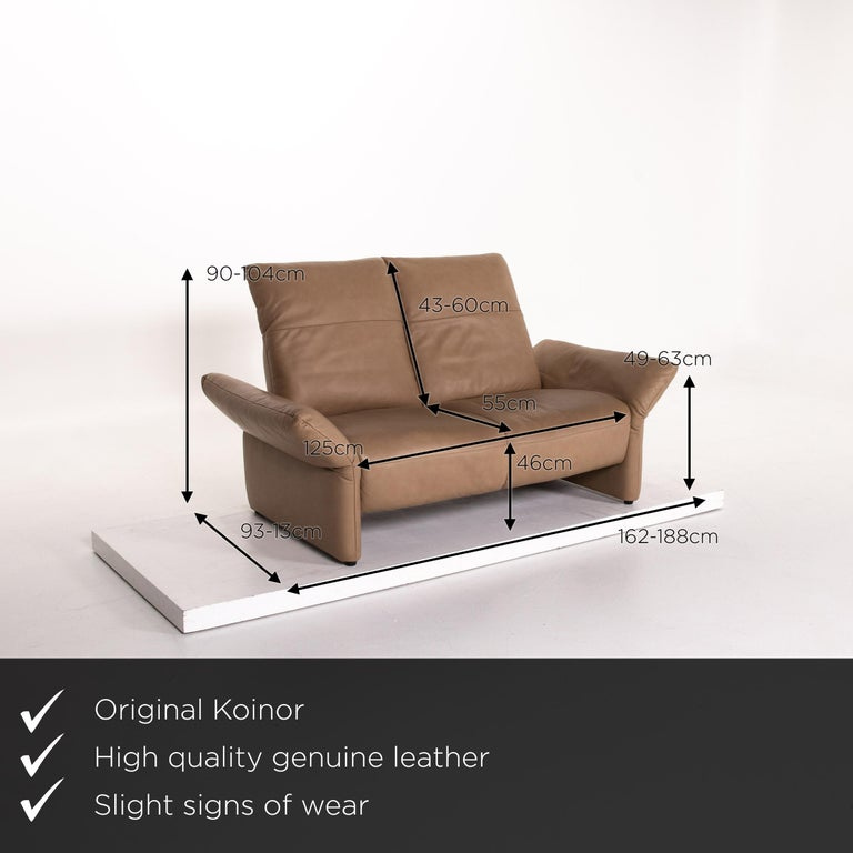 We present to you a Koinor Elena leather sofa brown two-seat function couch.       Product measurements in centimeters:    Depth 93 Width 162 Height 90 Seat height 46 Rest height 49 Seat depth 55 Seat width 125 Back height 43.