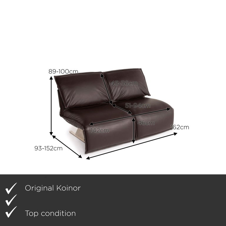 We present to you a Koinor Evia leather sofa brown dark brown two-seater relax function function.