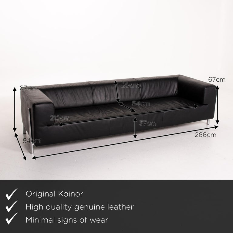 We present to you a Koinor Genesis leather sofa black four-seat couch.    Product measurements in centimeters:    Depth 54 Width 266 Height 67 Seat height 37 Rest height 67 Seat depth 54 Seat width 37 Back height 29.