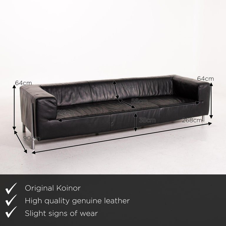 We present to you a Koinor genesis leather sofa black four-seat couch      Product measurements in centimeters:    Depth 90 Width 268 Height 64 Seat height 38 Rest height 64 Seat depth 56 Seat width 212 Back height 27.